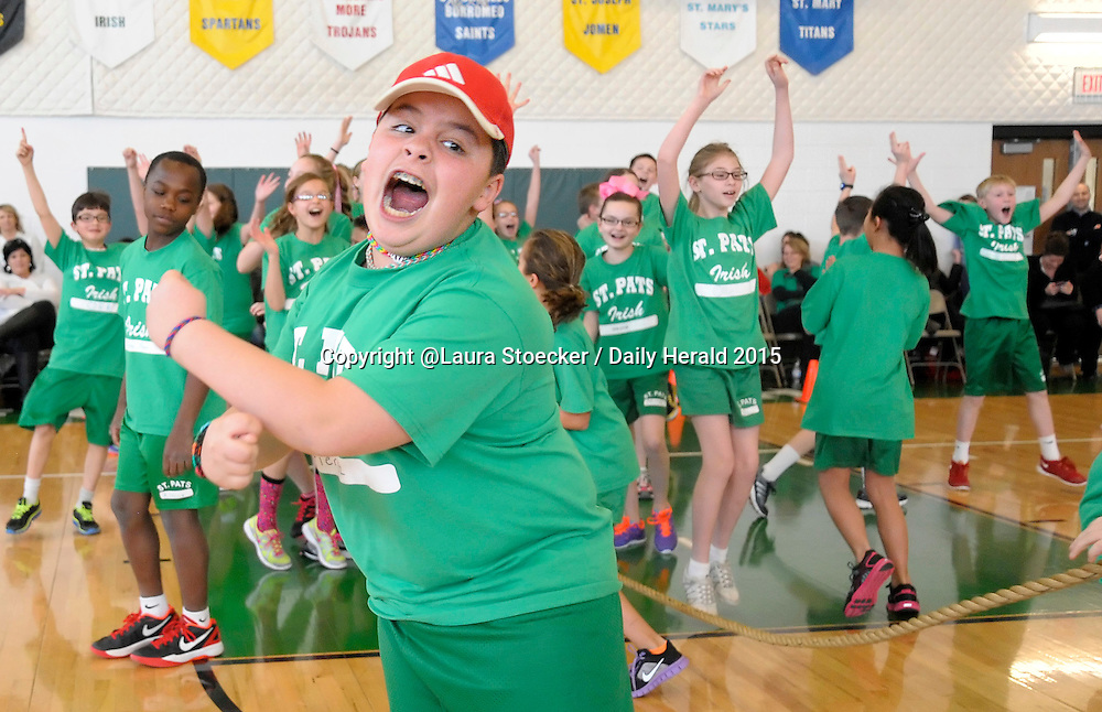 Laura Stoecker/lstoecker@dailyherald.com<br /> Lucas Gutierrez, 11, of St. Charles and teammates celebrate their victory in the 'Tug of War' competition at St. Patrick School in St. Charles during their Catholic Schools Week assembly Wednesday.