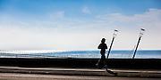 Runner passing Aramarama Millenium Footbridge, Mission Bay, Tamaki Drive, Auckland.