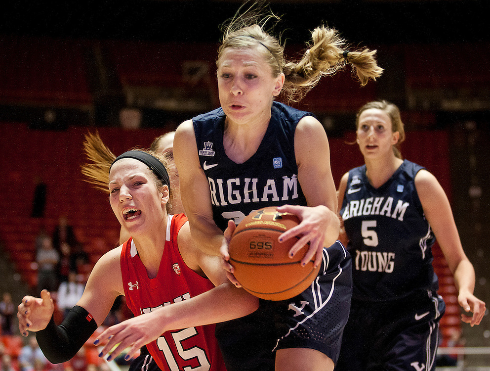 BYU guard Haley Steed (33) pulls in a rebound over Utah forward Michelle Plouffe (15) during the second half of the NCAA Women's Basketball game between Utah and BYU at the Jon M. Huntsman Center, Saturday, Dec. 8, 2012.