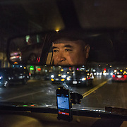 "WASHINGTON, DC - APR 4:  UberX driver Ali Jaghori picks up a customer on 14th Street, April 4, 2014, in Washington, DC. Jaghori, a former Washington Flyer driver, now drives soley for UberX. Thousands of local car owners have signed up in recent months to drive with one of the ""ride-share"" operators that use smartphone apps to link people needing rides with car owners willing to give them, for a price. (Photo by Evelyn Hockstein/For The Washington Post)"