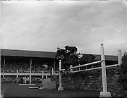 "05/08/1960<br /> 05/08/1960<br /> 05 August 1960<br /> R.D.S Horse Show Dublin (Friday). Aga Khan Trophy. Lieut-Col. Carlos Delia (Argentina) on ""Huipil"", clears the stone wall on his 2nd round, to give Argentina victory in the Aga Khan Jumping Competition at the Dublin Horse Show."