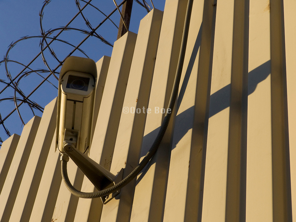 surveillance camera on fenced off area