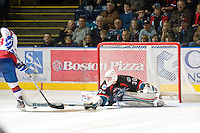 KELOWNA, CANADA, NOVEMBER 11: Jordon Cooke #30 of the Kelowna Rockets makes a poke check as the Edmonton OIl Kings visit the Kelowna Rockets  on November 11, 2011 at Prospera Place in Kelowna, British Columbia, Canada (Photo by Marissa Baecker/Shoot the Breeze) *** Local Caption *** Jordon Cooke;