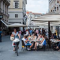 """People enjoy """"aperitivo"""" in Piazza dell'Uità d'Italia in Trieste, Italy."""