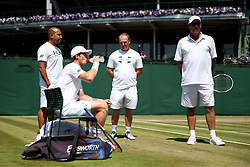 Andy Murray during a practice session with coach Ivan Lendl (right), Fitness coach Matt Little (centre) and Physio Shane Annun (left) on day five of the Wimbledon Championships at The All England Lawn Tennis and Croquet Club, Wimbledon.