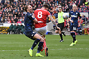 Leeds United defender clashes into Bristol City midfielder Josh Brownhill (8) during the EFL Sky Bet Championship match between Bristol City and Leeds United at Ashton Gate, Bristol, England on 9 March 2019.