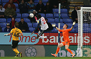 Bolton Wanderers Joe Dodoo in action past Southend United goalkeeper Nathan Bishop during the EFL Sky Bet League 1 match between Bolton Wanderers and Southend United at the University of  Bolton Stadium, Bolton, England on 21 December 2019.