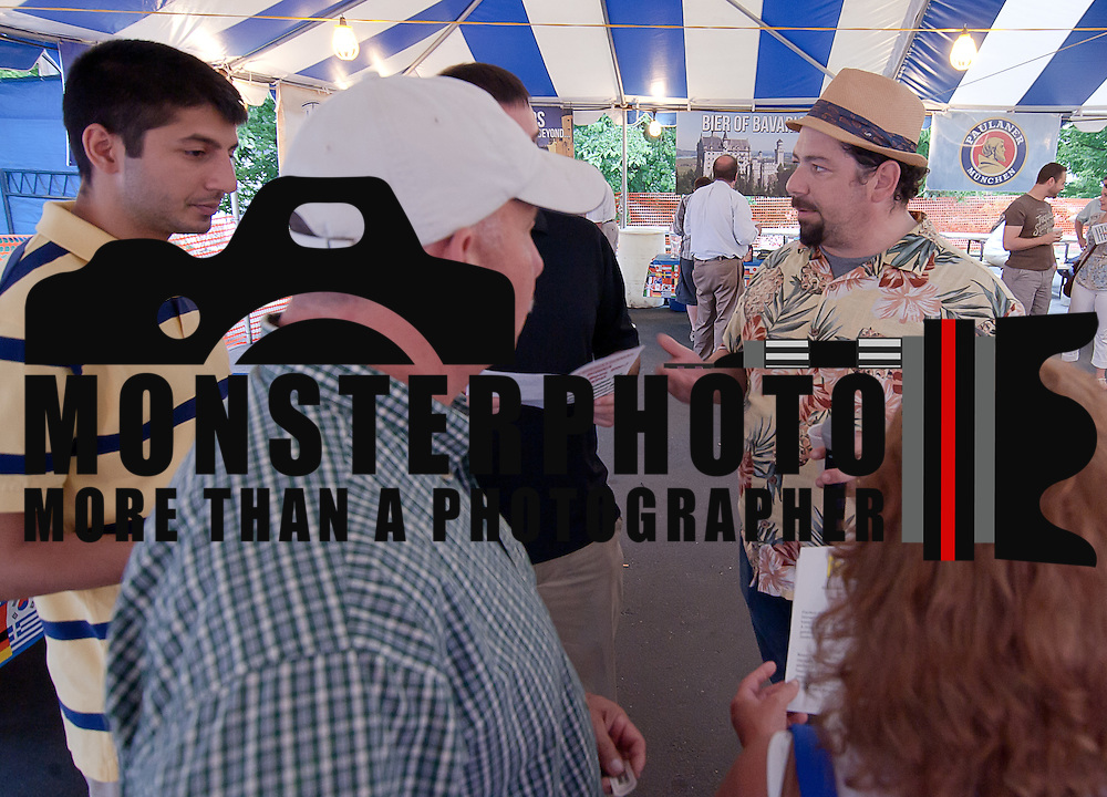 06/11/12 Wilmington Del: Burke Morrison (Right) a certified Cicerone, discuss variety of brewing styles, ingredients, and flavors with attendees during the inaugural International Beer Tasting Event Monday, June 11, 2012, at St. Anthony's Italian Festival in Wilmington Delaware...Special to The News Journal/SAQUAN STIMPSON