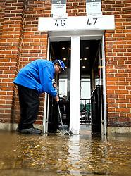 A steward sweeps water away from a flooded turnstile at Craven Cottage - Mandatory by-line: Robbie Stephenson/JMP - 26/08/2018 - FOOTBALL - Craven Cottage - Fulham, England - Fulham v Burnley - Premier League