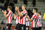 Asa Hall, Aaron Downes and Billy Waters thank the fans during the The FA Cup match between Hartlepool United and Cheltenham Town at Victoria Park, Hartlepool, England on 7 November 2015. Photo by Antony Thompson.