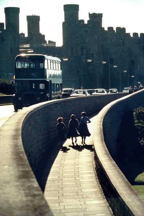 Wales, Conwy Castle, three women walking on bridge
