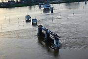 Nederland, grens Limburg - Noord-Brabant, Gemeente Boxmeer, 10-01-2011. .Het sluis en stuwcomplex Sambeek bij hoogwater van de Maas. Het hoogwater Maas is een gevolg van sneeuwsmelt en neerslag in de bovenloop van de rivier. De stuw is gestreken en de scheepvaart kan  gebruik maken van de vaargeul naast de stuwtorens. De schutsluizen staan geheel onder water, de bedieningsgebouwen staan op kolommen boven het water. Het complex is gebouwd in het kader van de kanalisatie van de Maas in de jaren 1918 - 1929..Lock and weir complex Sambeek at high waters of river Meuse. The flood is due to snow melt and precipitation upstream. The weir is 'lifted' allowing for ships to pass. The normal shipping locks lock are completed flooded (and under water). The control buildings are build on columns. The whole complex was built in the context of the canalization of the Meuse in the years 1918 to 1929..luchtfoto (toeslag), aerial photo (additional fee required).© foto/photo Siebe Swart