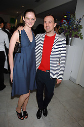 LISA KENT and photographer TIM WALKER at a reception hosted by Vogue magazine to launch photographer Tim Walker's book 'Pictures' sponsored by Nude, held at The Design Museum, Shad Thames, London SE1 on 8th May 2008.<br />