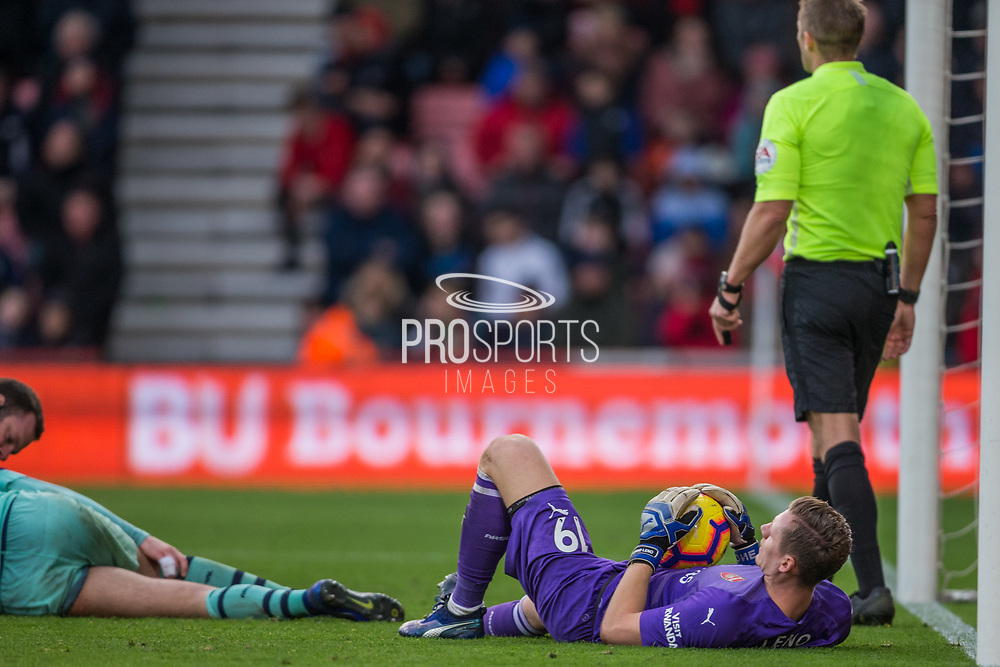 Bernd Leno (GK) (Arsenal) looking up to see how Shkodran Mustafi (Arsenal) is following treatment during the Premier League match between Bournemouth and Arsenal at the Vitality Stadium, Bournemouth, England on 25 November 2018.