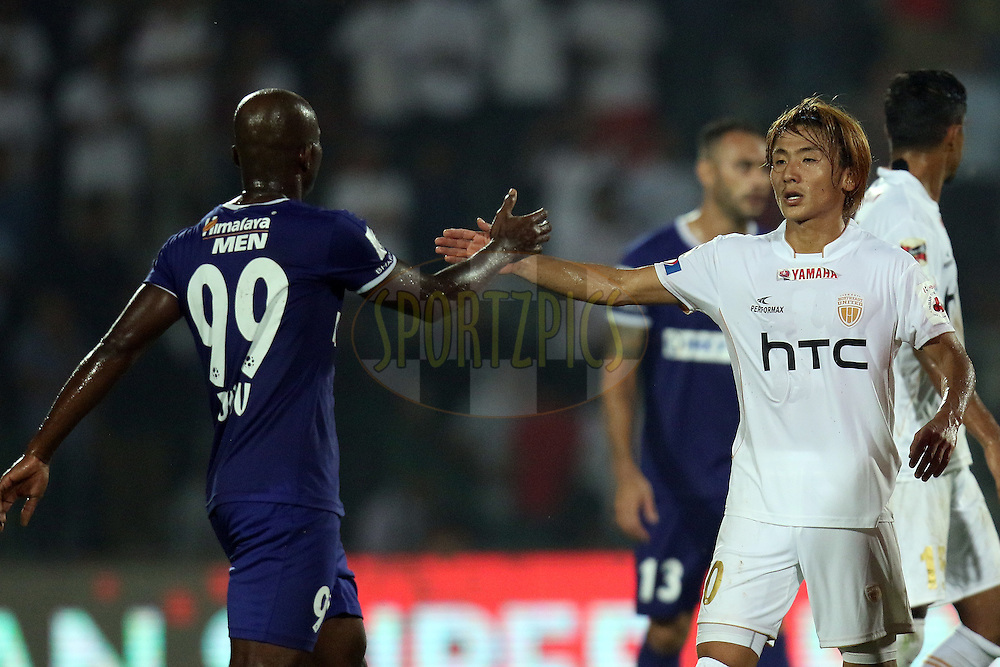 Katsumi Yusa of NorthEast United FC greets with Dudu Omagbemi of Chennaiyin FC during match 18 of the Indian Super League (ISL) season 3 between NorthEast United FC and Chennaiyin FC held at the Indira Gandhi Athletic Stadium in Guwahati, India on the 20th October 2016.<br /> <br /> Photo by Rahul Goyal / ISL/ SPORTZPICS