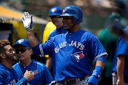 OAKLAND, CA - JULY 23:  Edwin Encarnacion #10 of the Toronto Blue Jays is congratulated by teammates in the dugout after scoring a run against the Oakland Athletics during the sixth inning at O.co Coliseum on July 23, 2015 in Oakland, California. The Toronto Blue Jays defeated the Oakland Athletics 5-2. (Photo by Jason O. Watson/Getty Images) *** Local Caption *** Edwin Encarnacion