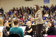 Anamosa High School Band Teacher Letitia Ceynar directs the band as they play for the 14th Annual Veterans Day Assembly at Anamosa High School in Anamosa on Tuesday, November 11, 2008.  (Stephen Mally/Freelance)