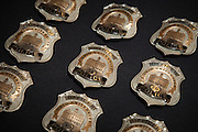 The newly designed badges await to be pinned on the officers of the Ohio University Police Department.  Photo by Ohio University / Jonathan Adams