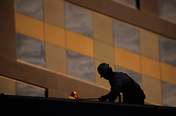 Stock photo of workman on the roof during new construction at George R. Brown Convention Center in Houston, Texas
