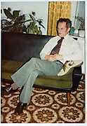 man sitting on a bench at home 1980s Holland