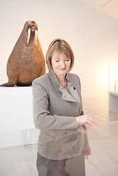 "© London News Pictures. 25/6/2013. Margate, Kent. Harriet Harman MP stands in front of the Horniman Museum walrus. Today Harriet Harman MP, Labour's Deputy Leader and Shadow Secretary of State for Culture, Media and Sport, visits Margate where she was given a tour of Turner Contemporary before meeting staff and local businesses in the ""Curious Margate"" project. Picture credit Manu Palomeque/LNP"