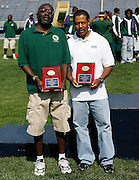 Hampton Lady Pirate head coach Maurice Pierce and Norfolk State men's coach Kenneth Giles pose during the 2006 MEAC Track and Field Championships in Greensboro, North Carolina.  May 07, 2006  (Photo by Mark W. Sutton)