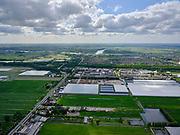 Nederland,Zuid-Holland, NESSELANDE; 14–05-2020; zicht op kassengebied van de Zuidplaspolder en nieuwbouwwijk van Nieuwerkerk aan den IJssel en het Groene Hart. Hollandse IJssel in het verschiet.<br /> View of the greenhouse area of the Zuidplaspolder and the new housing estate of Nieuwerkerk aan den IJssel and the Green Heart.<br /> <br /> luchtfoto (toeslag op standaard tarieven);<br /> aerial photo (additional fee required)<br /> copyright © 2020 foto/photo Siebe Swart