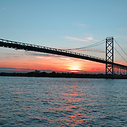 Ambassador Bridge at sunset over the Detroit River.