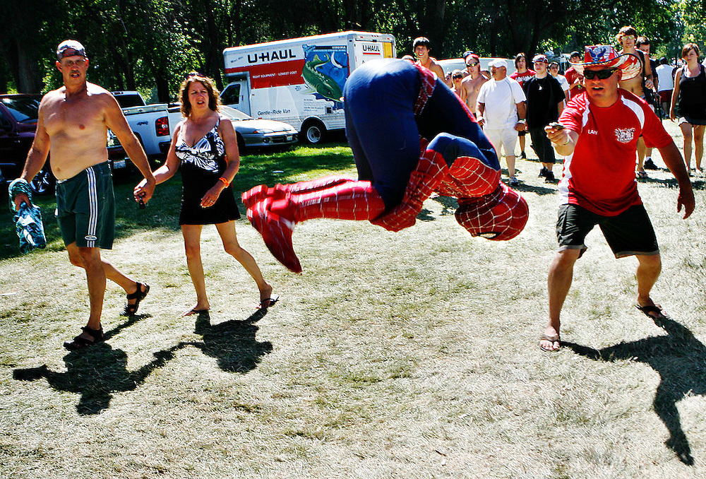 Spiderman gives an impromptu performance while heading to the Kids' Zone in Kennewick.