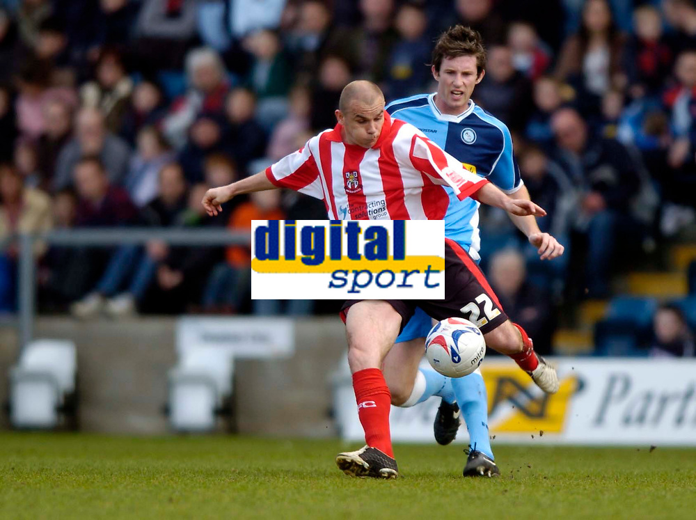 Photo: Richard Lane.<br />Wycombe Wanderers v Lincoln City. Coca Cola League 2. 17/04/2006. <br />Lincoln's Jamie Forrester is challenged by Wycombe's Joe Burnell.