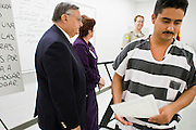 "06 NOVEMBER 2006 - PHOENIX, AZ: Maricopa County Sheriff JOE ARPAIO hands out certificates on completion to Spanish speaking prisoners who complete a two week English class in the county jail. Sheriff Joe Arpaio is offering intensive two week English classes in the Maricopa County Jails so county prisoners can communicate with Detention Officers. The classes teach ""jail English"" so inmates can report medical problems, request their lawyers, request bedding etc. There are more than 1,000 illegal immigrants in the county jail system. In 2011, the US Department of Justice issued a report highly critical of the Maricopa County Sheriff's Department and the jails. The DOJ said the Sheriff's Dept. engages in widespread discrimination against Latinos during traffic stops and immigration enforcement, violates the rights of Spanish speaking prisoners in the jails and retaliates against the Sheriff's political opponents.      PHOTO BY JACK KURTZ"