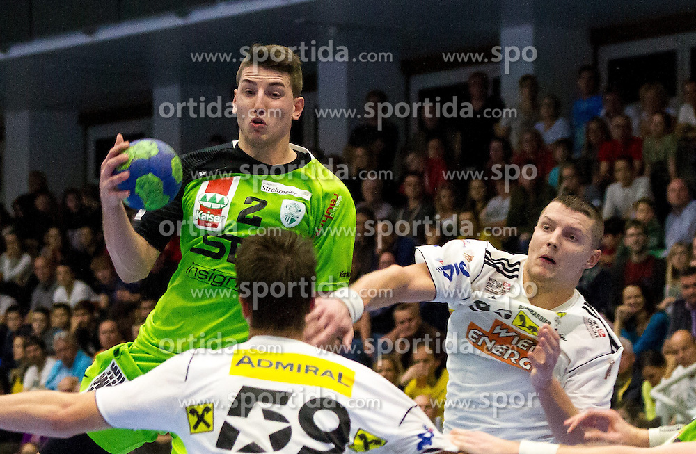 11.10.2014, BSFZ Suedstadt, Maria Enzersdorf, AUT, HLA GD, SG West Wien vs Bregenz Handball , im Bild Alexander Hermann (SG West Wien), Romas Kirveliavicius (Fivers WAT Margareten)// during the Handball League Austria Match between SG West Wien and Fivers WAT Margareten at the BSFZ Suedstadt, Maria Enzersdorf, Austria on 2014/10/11, EXPA Pictures © 2014, PhotoCredit: EXPA/ Sebastian Pucher