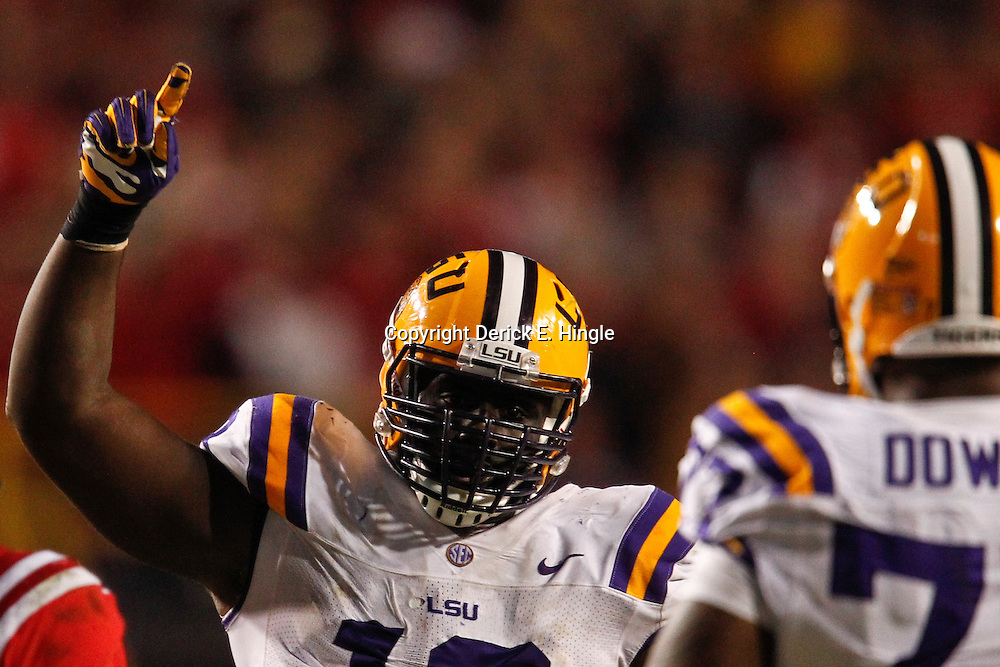 November 17, 2012; Baton Rouge, LA, USA  LSU Tigers defensive tackle Bennie Logan (18) against the Ole Miss Rebels during a game at Tiger Stadium. LSU defeated Ole Miss 41-35. Mandatory Credit: Derick E. Hingle-US PRESSWIRE