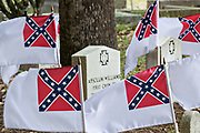 Confederate flags mark the tombs of sailors from the submarine H.L. Hunley during Confederate Memorial Day at Magnolia Cemetery May 11, 2019 in Charleston, South Carolina. The Hunley was the first submarine to sink a warship in combat during the Civil War in Charleston Harbor.