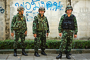 "01 FEBRUARY 2014 - BANGKOK, THAILAND: Thai soldiers on a sidewalk near a closed polling place in Bangkok. Thais went to the polls in a ""snap election"" Sunday called in December after Prime Minister Yingluck Shinawatra dissolved the parliament in the face of large anti-government protests in Bangkok. The anti-government opposition, led by the People's Democratic Reform Committee (PDRC), called for a boycott of the election and threatened to disrupt voting. Many polling places in Bangkok were closed by protestors who blocked access to the polls or distribution of ballots. The result of the election are likely to be contested in the Thai Constitutional Court and may be invalidated because there won't be quorum in the Thai parliament.    PHOTO BY JACK KURTZ"