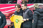Thomas Frank, Head Coach of Brentford FC & Frank Lampard, Manager of Derby County FC celebrating 'Kick it Out' Saturday with a t-shirt during the EFL Sky Bet Championship match between Brentford and Derby County at Griffin Park, London, England on 6 April 2019.