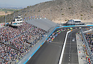 Nov. 12 2011; Avondale, AZ, USA; NASCAR Nationwide Series driver Carl Edwards (left) and Aric Almirola (right) leads the pack during the Wypall 200 at Phoenix International Raceway. Mandatory Credit: Jennifer Stewart-US PRESSWIRE