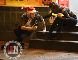 Manchester UK  24.12.2016: Images from Manchesters Gay Village during the Mad Friday celebrations this on the 23 and 24th of December,<br /> <br /> A female helps a  friend off the floor