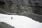 Hikers on the Eiger Trail by the Eiger Glacier, Eigergletscher, in Swiss Alps, Bernese Oberland, Switzerland