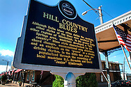 A plaque from the Mississippi Blues Commission commemorates Holly Springs' historic blues heritage Oct. 10, 2011 in downtown Holly Springs, Miss. The town is the birthplace of musicians R.L. Burnside and Junior Kimbrough, who popularized the hill country blues style. (Photo by Carmen K. Sisson/Cloudybright)