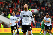 Richard Keogh (6) of Derby County celebrates in front of the Derby fans at full time after a 2-0 win over Bristol City during the EFL Sky Bet Championship match between Bristol City and Derby County at Ashton Gate, Bristol, England on 27 April 2019.
