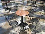 many chairs placed around a small round table