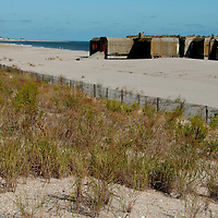 A bunker, a relic of World War II, stands at water's edge at Cape May Point in southern New Jersey.