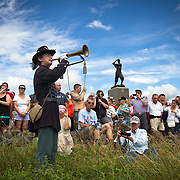 Alan Tobert, 15, of Shippensberg, PA, plays Taps,  in front of the 72nd Pennsylvania Infantry Monument, at the conclusion of the Pickett's Charge Commemorative March, during the Sesquicentennial Anniversary of the Battle of Gettysburg, Pennsylvania on Wednesday, July 3, 2013.  The march was an opportunity to follow in the footsteps of Confederate soldiers by walking with living historians and park rangers along the path of the famously ill-fated Pickett's Charge, which brought to a close The Battle of Gettysburg when the Union Army repelled their advance. Taps was first thought to have been played at a military funeral or memorial service in 1862, at the burial of a Union soldier.  The Battle of Gettysburg lasted from July 1-3, 1863 resulting in over 50,000 soldiers killed, wounded or missing.  John Boal Photography