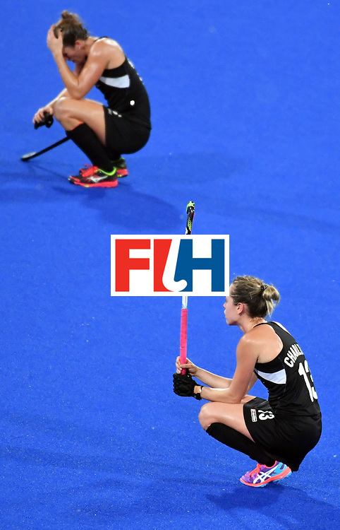 New Zealand's Samantha Charlton (R) reacts after loosing the women's semifinal field hockey New Zealand vs Britain match of the Rio 2016 Olympics Games at the Olympic Hockey Centre in Rio de Janeiro on August 17, 2016. / AFP / Pascal GUYOT        (Photo credit should read PASCAL GUYOT/AFP/Getty Images)