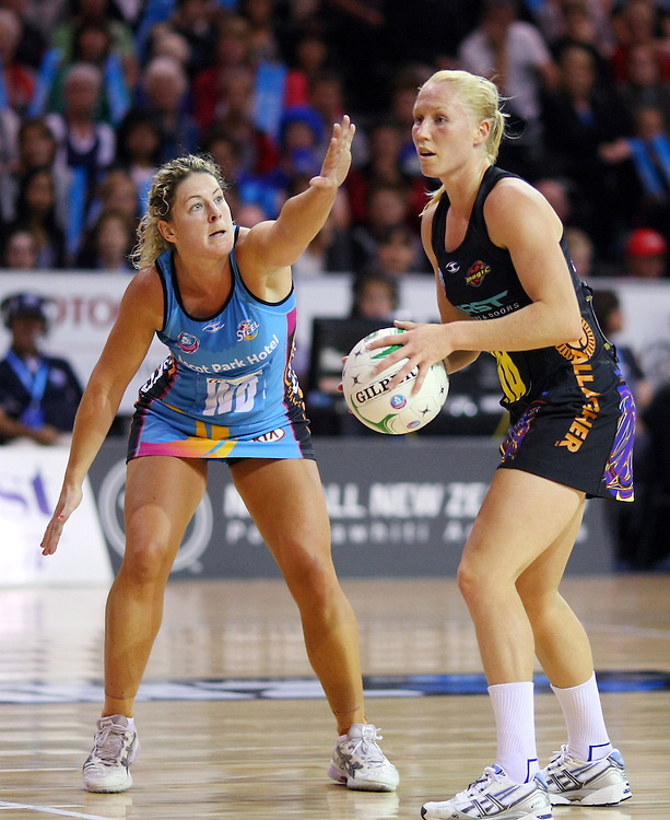 Southern Steel's Phillipa Finch, left, attempts to defend the pass of Magic's Laura Langman in the ANZ Netball Championships at Invercargill Velodrome, Invercargill, New Zealand, Monday, April 02, 2012. Credit:SNPA / Dianne Manson