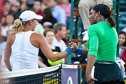 July 26, 2011; Stanford, CA, USA;  Serena Williams (USA), right, shakes hands with Anastasia Rodionova (AUS), left, after the first round of the Bank of the West Classic women's tennis tournament at the Taube Family Tennis Stadium. Williams defeated Rodionova 6-0, 6-0.