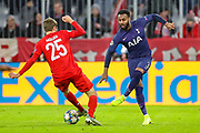 Tottenham Hotspur defender Danny Rose (3) tries to clear the ball from Bayern Munich forward Thomas Müller (25) during the Champions League match between Bayern Munich and Tottenham Hotspur at Allianz Arena, Munich, Germany on 11 December 2019.