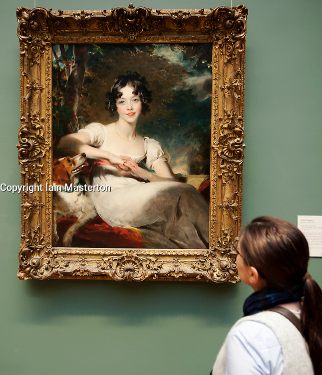 Woman looking at painting of Lady Somerville by Sir Thomas Lawrence at Metropolitan Museum of Art in Manhattan , New York City, USA