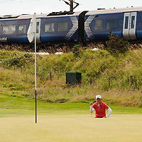 Picture by Christian Cooksey/CookseyPix.com . Standard repro rates apply. <br /> <br /> Aberdeen Asset Management Ladies Scottish Open at Dundonald Links, Irvine Ayrshire. <br /> <br /> Catriona Matthew waits for a train to pass before putting on the 13th.